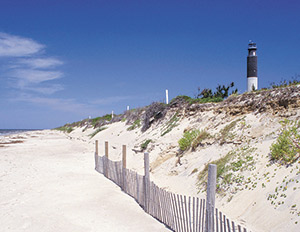 pictguresque photo of the beach and Sullivan's Island Lighthouse in Sullivan's Island, SC
